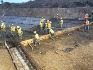 Men making concrete forms