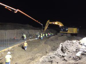 excavator digging at night